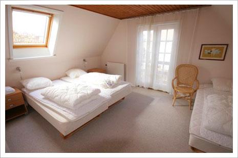 Et af soveværelserne i Postgadehuset.
